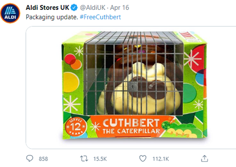 """Tweet from @AldiUK with a picture of a caterpillar cake in a cage, reading """"Packaging update"""""""