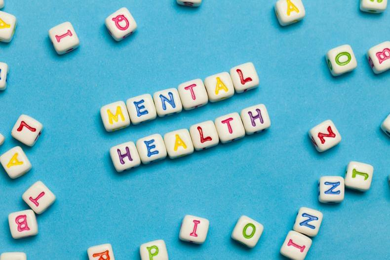 Letter cubes spelling out mental health